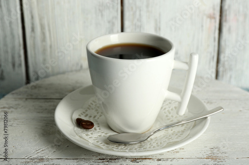 Staande foto Thee Cup of coffee with beans on color rustic wooden background