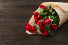 Red Roses Wrapped In Paper On ...