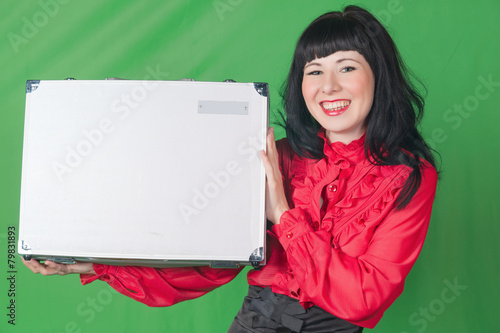 Fotografía  young woman in office dress with case on green background