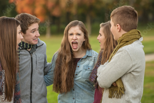 Photo Startled Teens with Yelling Friend