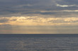 light rays falling through clouds on the sea surface