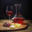 Käse und Wein vor dunklem Hintergrund