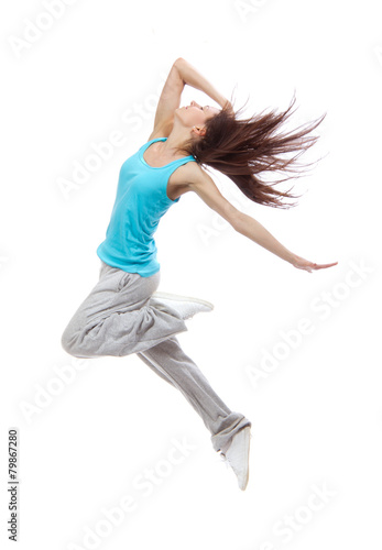 Foto  New pretty modern slim hip-hop style dancer teenage girl jumping