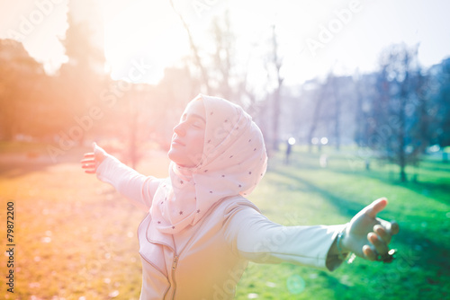 Obraz na płótnie young beautiful muslim woman at the park