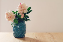 Blue Moroccan Style Vase Of Large White And Pink Flowers