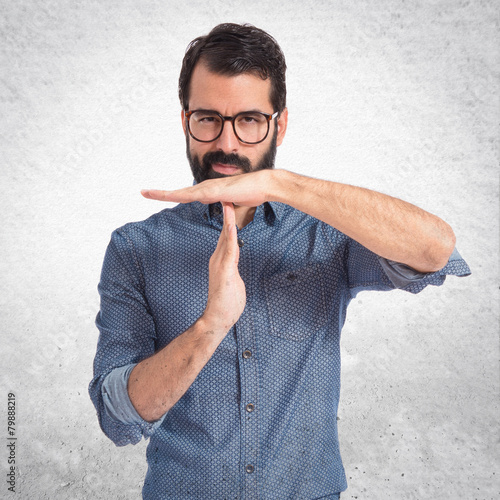 Fotografie, Obraz  Young hipster man making time out gesture