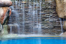 Waterfall Decorate In The Pool And Blue Tone