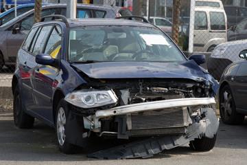 A blue wrecked car