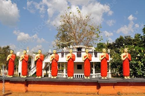 Fotografie, Obraz  Buddhist Disciple statues at a temple in Sri Lanka