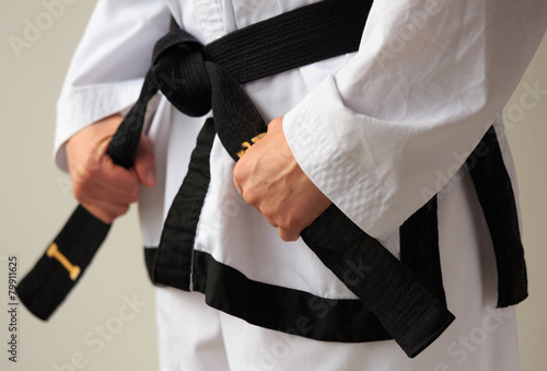 Deurstickers Vechtsport Taekwon-do woman with black belt.