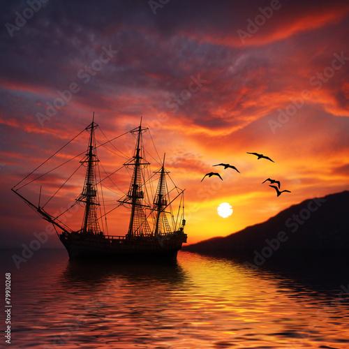 Foto op Canvas Baksteen Sailboat against beautiful sunset landscape
