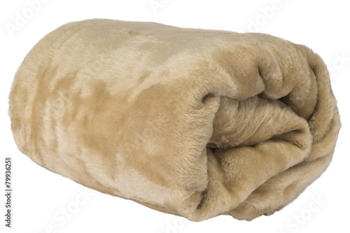 Photo  Fluffy, brown blanket rolled on a white background