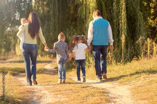 Fototapeta Family Ties concept. Big happy family walking obraz
