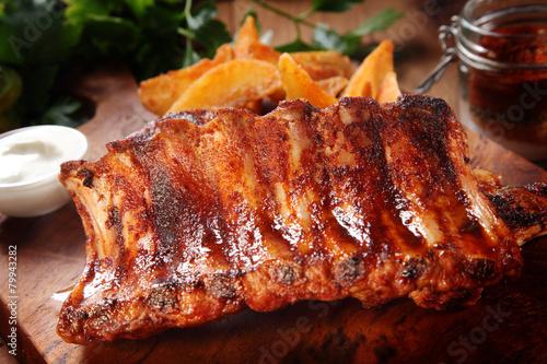 Aluminium Prints Grill / Barbecue Roasted Pork Rib on Wooden Chopping Board