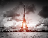 Fototapeta Wieża Eiffla - Effel Tower, Paris, France. Black and white with red sun light