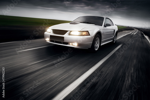 Photo  Speed Car Clouds Asphalt