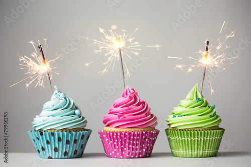 Three cupcakes with sparklers Canvas Print