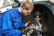 auto mechanic at car brake shoes eximining