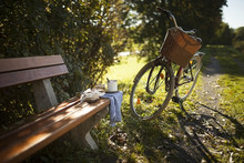 Bicycle Next To On Wooden Bench