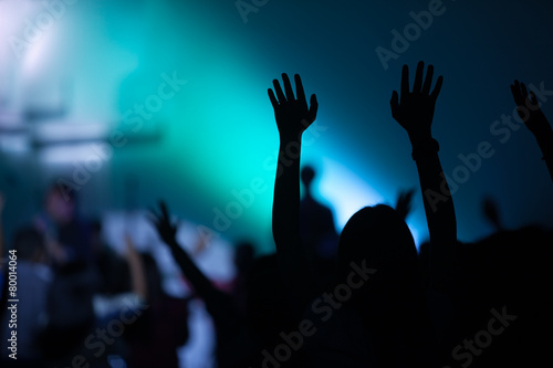 christian music concert with raised hand Wallpaper Mural
