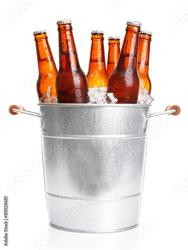 Fényképezés  Glass bottles of beer in metal bucket isolated on white