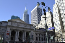 NY Public Library Façade With Bryant Park On The Background