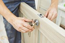 Carpenter At Door Lock Install...