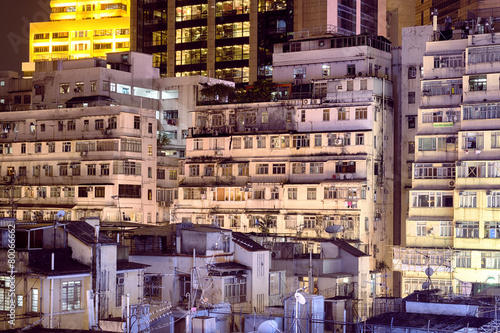 Fototapety, obrazy: Apartment buildings at night in Hong Kong.