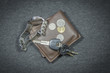 Wallets and car key of wristwatch have coin money