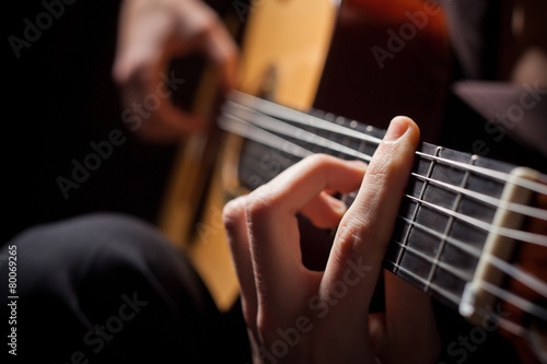 Man playing acoustic guitar Canvas Print