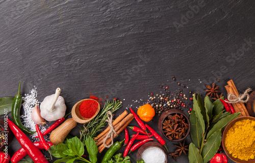 Photo  Various spices on black stone