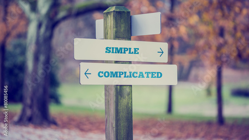 Fotografie, Obraz  Rustic wooden sign in an autumn park with the words Simple - Com