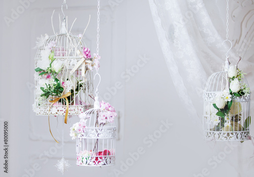 Fotografie, Obraz  White decorative cage with beautiful flowers, suspension cells