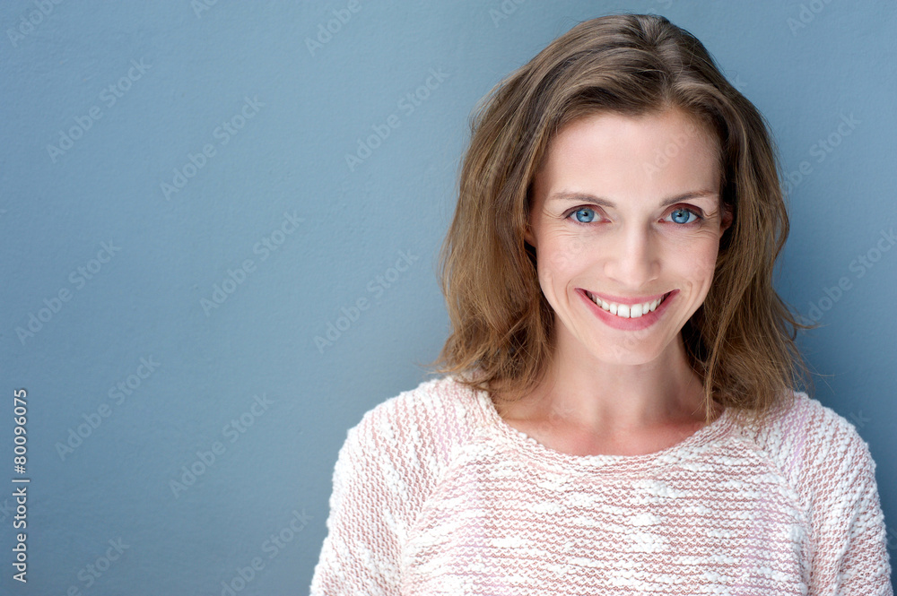 Fototapety, obrazy: Beautiful older woman smiling with sweater