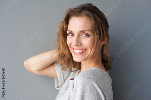 Happy smiling beautiful woman posing with hand