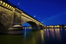 London Bridge At Night, Spanning The Waters Of Lake Havasu. Reflections In Calm Water.