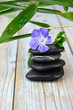 Black warmth zen stones decoration on old wooden background