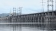 Traffic at dam of Hydroelectric power station on river
