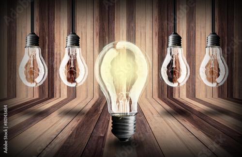 lightbulb  on wood planks texture background