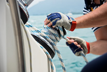 Winch And Sailors Hands On A S...