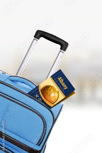 Fotografia, Obraz  Albany. Blue suitcase with guidebook.
