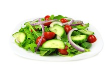 Salad With Greens, Tomatoes, Red Onions And Cucumber Isolated