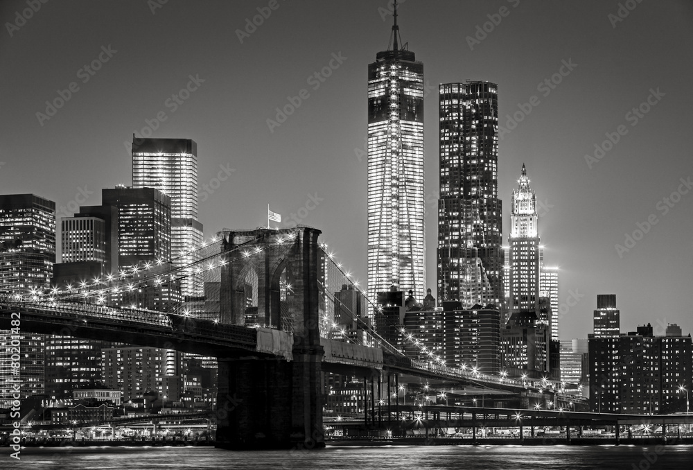 Fototapeta New York by night. Brooklyn Bridge, Lower Manhattan – Black an