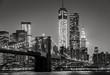 New York by night. Brooklyn Bridge, Lower Manhattan – Black an