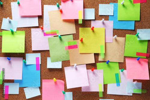 Fotografie, Obraz  Image of colorful sticky notes on cork bulletin board