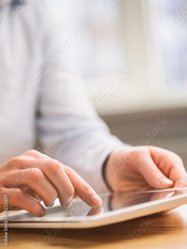 Photo  Businesswoman Uses a Tablet
