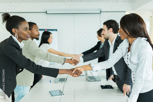 Fototapety, obrazy: Business people shaking hands as a sign of greeting
