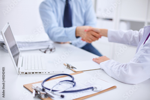 Doctor and Patient sitting on the desk Wallpaper Mural