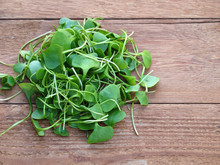 Watercress On Wooden Background. Top View.