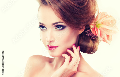 Poster  Spring freshness. Girl with delicate pastel flowers in hair
